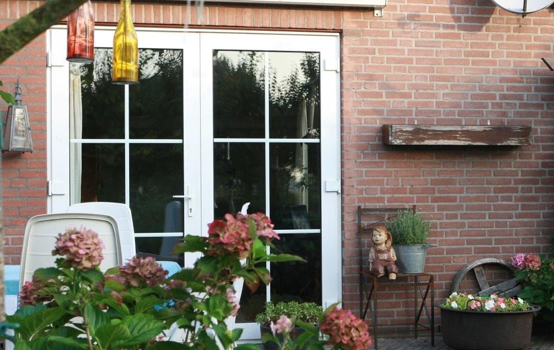 Openslaande deuren van hardhout aluminium en hardhout
